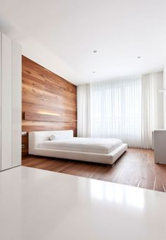 two tones white and walnut plated bedroom ideas with modern platform bed beside the large white vertical curtains: a graceful apartment filled with walnut and white