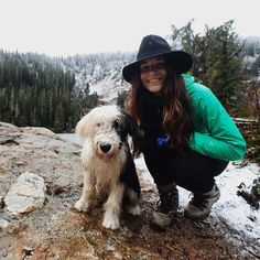 A girl her dog and a hike