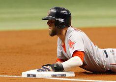 Dustin Pedroia Photos Photos - Dustin Pedroia #15 of the Boston Red Sox dives…