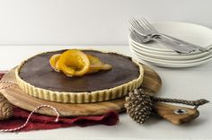 Chocolate Ganache Tart with Vanilla Bean Pastry and Candied Orange - Queen Fine Foods. Click for recipe.