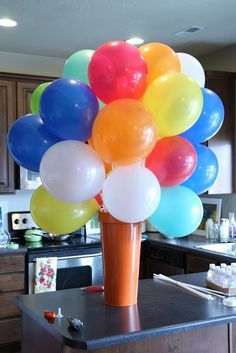 Balloon centerpiece without helium. Balloons are air-filled and attached to sticks.