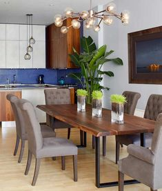 live edge dining table with tufted upholstered chairs