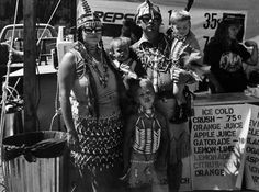 """Joe Cantrell (Cherokee, b. 1945)    GRANDE RONDE POW-WOW 1992  Gelatin silver print  11"""" x 14""""    """"Newcomers to 'pows' are often confused by the sideshow atmosphere outside the arena-it can get a little out of hand at times-but I suppose many expect only solemn ceremonies around a fire or something. This is an expression of our religion and I'm happy it includes humor."""""""
