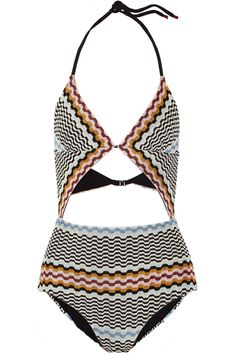 The completely cutout front draws eyes to the flattering, triangle cups. #refinery29 http://www.refinery29.com/strappy-bikinis#slide-17