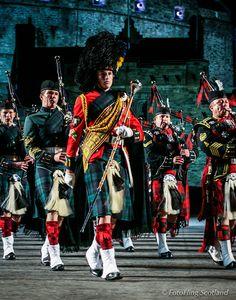 Edinburgh Military Tattoo Pipe Band playing in the forecourt of Edinburgh Castle, Scotland