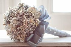 Jeweled bouquet - keep it forever!  This one is a bit much, but if I could pull it off, it would be made of vintage broches.  What do you think?  Any interest?