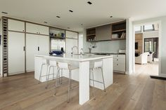 Band-sawn oak flooring is used throughout the house, and is extended to the cabinetry borders in the kitchen.