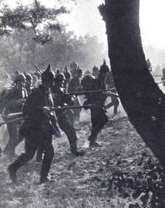 1914 and World War One: German troops advance cautiously through enemy territory. Note their spike helmets, identifying them as German, ca. 1914-15.