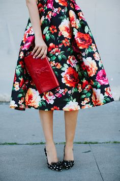 Saturated Floral & Black Pleated Midi Skirt, Black & White Polka Dot Bow Heels, Deep Red YSL Clutch // bold