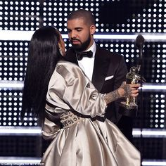 Awkward moment: He handed her the coveted golden Moonman