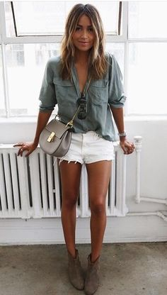 Chambray shirt, white shorts and boots.