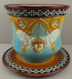 """BROWNFIELD majolica planter and underplate, Gothic arches, trefoil medallions, winged putti heads, 18""""d, 14""""h"""