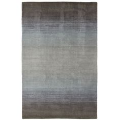 Ombre, the gradual blending of light to dark of the same color, has been used in home decor for years. In intriguing charcoal, our wool rug will enliven your neutral furnishings or complement your window coverings, upholstery or pillows.