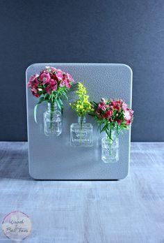 DIY magnet vase out of old nail polish bottles