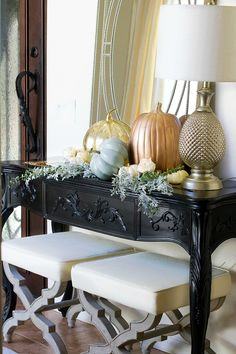 Painted pumpkins for a fall foyer vignette