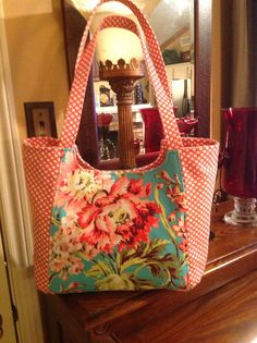 Pattern used is PDF download So Chick! Market Tote. Main fabric is Amy Butler. Side panel fabric from Hobby Lobby.