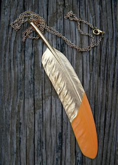 Dip a necklace charm in Plasti Dip to give it a new look!