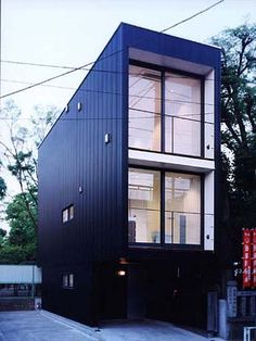 This modern prefab house is a three-story residential home in the Sumida area in Tokyo, Japan | Apollo Architects