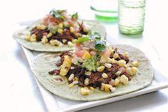 Spicy barbacoa soft tacos.