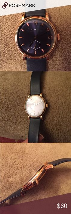 Navy and Rose Gold Marc by Marc Jacobs Watch New Authentic Marc by Marc Jacobs navy and rose gold watch! Genuine leather. I am wearing the watch on the smallest hole setting. My wrist is 2.5 inches wide and 5.75 inches in circumference. Marc By Marc Jacobs Accessories Watches
