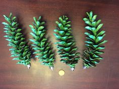 Hand painted pine cones. Undersides left natural. Ornament toppers added.
