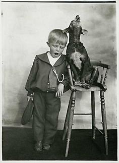 valscrapbook:    Small boy with a pet dog singing in unison by State Library of Victoria Collections on Flickr.
