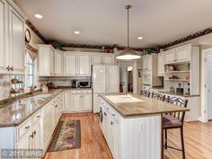 Traditional Kitchen with Athens Raised Panel Cabinets, Crema Caramel Granite Countertop, MS International