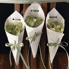 paper cones filled with flowers,  nyt tiedän mitä teen kuivatuille hortesioilleni :D