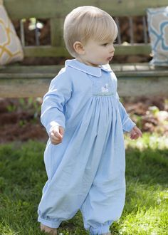Piped Chest Smocked Romper - Sheep Baaaa-utiful hand smocked sheep on the softest light blue corduroy. An adorable and detailed design for your sweet little one. White piping around the collar and sleeves with snags at legs.