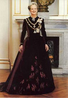 Queen Margrethe II of Denmark. Beautiful velvet gown with embossed design! I know Queen Margrethe designs many of her own clothes; I wonder if this is one of hers?
