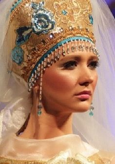 Russian bride in traditional style. She wears a kokoshnik headdress with a veil. #weddings