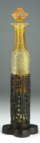 c.1870 TALL AMBER CUT GLASS SCENT PERFUME BOTTLE IN PIERCED METAL STAND