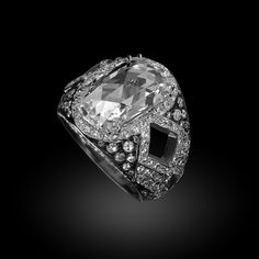 Carnet Harlequin Fantasy Ring with white diamonds set in platinum