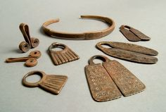 Africa | Collar and amulets from the Oromo and Arsi peoples of Ethiopia | Copper alloy | The patterns engraved on these items has an Arab feel to it.