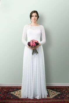 Beautiful Wedding Dresses and more lovingly designed and created in the heart of Wellington New Zealand by our small and experienced team at Sophie Voon Bridal. Illusion Neckline, Gathered Skirt, Lace Sleeves, Silk Satin, Sash, Whimsical, Folk, Gowns, Inspired