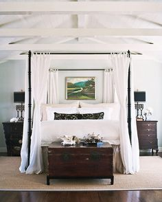 LOVE this room. The ceiling, the dark floors & dark furniture, the lovely white bed with the perfect canopy, even the rug & lamps. Beautiful.