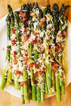 Oven-Roasted Asparagus with Bacon, Garlic, and Asiago cheese - perfect appetizer for all kinds of meat and fish. Healthy, gluten-free and low-carb recipe. This recipe provides detailed instructions on how to roast the asparagus in Asparagus Recipes Oven, Oven Roasted Asparagus, Asparagus Bacon, How To Cook Asparagus, Bacon Recipes, Vegetable Recipes, Cooking Recipes, Healthy Recipes, Ina Garten Roasted Vegetables