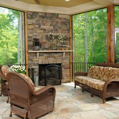 travertine tile screen porch with stone outdoor fireplace | for