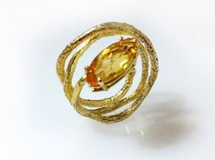 "On my Lust List: the earthy elegance of #EmanuelaDuca 's hand wrought #citrine and gold ""Ghibli"" #ring. Discovered at Fashion's Night Out last fall, when I also met the artisan herself at Joan Shepp Boutique's US Made soiree.  Wouldn't this be like having a little burst of sunshine on your finger?   And it just happens to fit perfectly ....  photo courtesy http://www.emanueladuca.com/index.php"