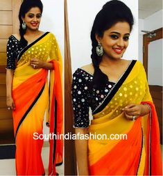 Priyamani wears a statement blouse with her dual coloured saree. Love her makeup, earring and braid hairstyle. Visit us at https://www.facebook.com/pages/Zarah/1578754045707532