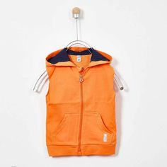 Your little one will look adorable when he wears this boys' orange hooded vest. This vest will keep him feel cozy while boosting his overall look. Orange Vests, Hooded Vest, Made Clothing, Boy Fashion, Adidas Jacket, Flannel, Hoods, Latest Trends, Kids Outfits