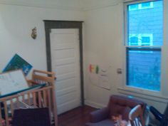 """Our nursery makeover: another """"before"""" pic of the junk room that was transformed into the girls' room"""