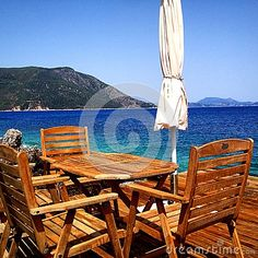 Table With A View Of The Ocean in Greece  - Download From Over 26 Million High Quality Stock Photos, Images, Vectors. Sign up for FREE today. Image: 44816520