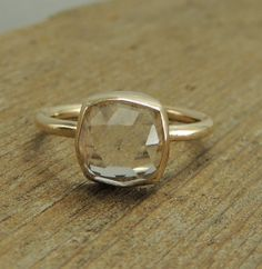 [[ Handmade Engagement Ring, White Topaz and Recycled 14k Gold, Rose Cut Topaz, Recycled Gold, Eco Friendly, Simple Engagement Ring. $395.00, via Etsy. ]]
