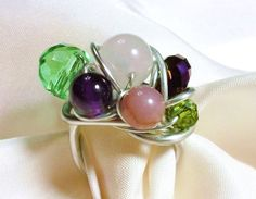 Items similar to Aluminum Wire Wrapped Beaded Ring with Genuine Stone and Glass Crystal - Purple, Green, Pink on Etsy Glass Crystal, Beaded Rings, Wire Wrapping, Purple, Pink, Pearl Earrings, Pearls, Stone, Crystals