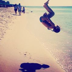 If you're a cheerleader and you go to the beach, it's a must to do a tuck on the beach.