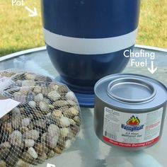 """Make a miniature """"fire put"""" for s'mores using flower pot, river rocks and chafing fuel."""