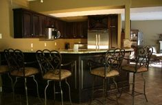 Lower level kitchen. Glazed cabinetry with front bar. For full details and before and after photos visit our website