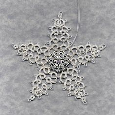 Star Snowflake.  Book:  Christmas Angels and Other Tatting Patterns by Monica Hahn.  Pattern:  5-Pointed Star.  Thread:  HH White 601 size 20.  Medallion:  http://www.firemountaingems.com