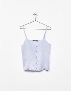 Strappy sateen top with buttons. Discover this and many more items in Bershka with new products every week